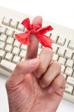 Red bow on finger Royalty Free Stock Photography