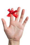 Red bow on finger Stock Photography