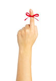 Red bow on finger Royalty Free Stock Images