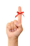 Red bow on finger Royalty Free Stock Photos
