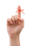 Red bow on finger Royalty Free Stock Image
