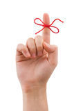 Red bow on finger Stock Image