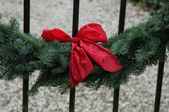 Red bow on a garland Royalty Free Stock Image