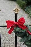 Red bow on a garland Royalty Free Stock Images