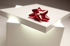 Red Bow Gift Box Lid Showing Very Bright Contents Royalty Free Stock Images