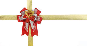 Red bow with gold ribbon on gift box Stock Photo