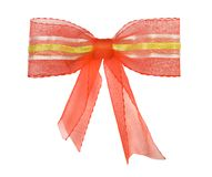 Red bow with gold tape and ribbons Stock Image