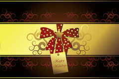 Red bow and golden frame on brown background. A red bow with golden stars and a golden frame on a dark brown background - Happy Holidays Royalty Free Stock Image