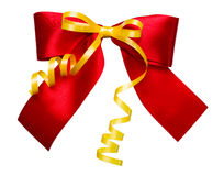 Red bow with golden ribbon made from silk Royalty Free Stock Photos