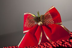 Red bow on gradient background. Cropped Stock Image