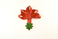 Red bow with green asterisk Stock Photo