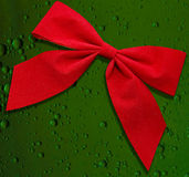 Red bow on green background Royalty Free Stock Images
