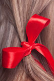 Red bow in a hair Stock Photography