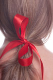 Red bow in a hair Stock Photos
