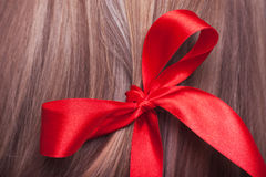 Red bow in a hair Royalty Free Stock Photography