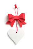 Red bow with a heart Royalty Free Stock Photos