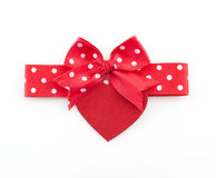 Red bow with heart shape Royalty Free Stock Photo