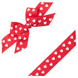 Red bow with hearts. And ribbon Royalty Free Stock Images