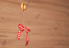 Red bow-knot and bagel. On the rope Royalty Free Stock Photo