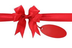 Red bow with label. Isolated on white background Stock Photography