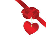 Red bow with a label - a heart Royalty Free Stock Images