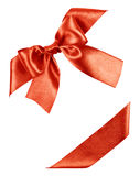 Red bow made from silk ribbon Stock Photo