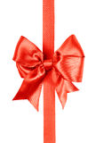 Red bow made from silk ribbon Stock Images