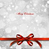 Red bow on a magical Christmas card. Vector. Big red bow on a magical Christmas letter Royalty Free Stock Photo