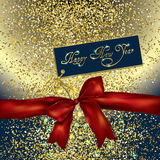 Red bow and new year greeting card on a gold glittery background Royalty Free Stock Images