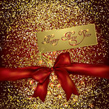 Red bow and new year greeting card on a gold glittery background Stock Image