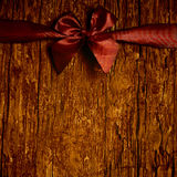 Red bow on old wooden.Copyspace Stock Images