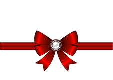 Red bow with ornament. Red bow with ribbon and brooch on a white background. Brooch with pearls. Invitation, greeting card or card template Royalty Free Stock Photo