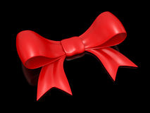 Red bow over black Royalty Free Stock Photography