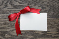 Red bow with paper card Stock Image