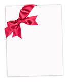 Red bow on paper sheet. Big red bow on paper sheet Royalty Free Stock Photos