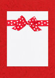 Red bow on paper sheet Royalty Free Stock Images