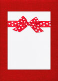Red bow on paper sheet Stock Photo