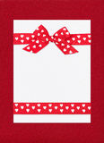 Red bow on paper sheet Royalty Free Stock Photography