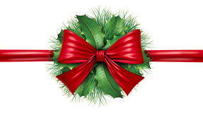 Red bow with pine border and circular decoration Royalty Free Stock Image