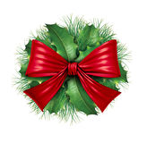 Red bow with pine circle decoration. Red silk bow with pine circular ornamental holiday decoration for Christmas festive winter celebration on a white background Royalty Free Stock Photos