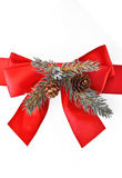 Red bow and pine cone decoration Royalty Free Stock Photo