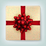 Red bow on polka dot gift box top view. EPS10. Vector birthday background stock illustration