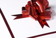 Red bow present 1. A present with a red bow and trim with space for a message Royalty Free Stock Photos
