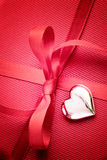 Red bow on present Royalty Free Stock Image