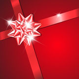 Red bow on a red ribbon with red background Stock Images
