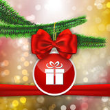Red bow and red sticker with gift sign hanging on Christams tree Royalty Free Stock Image