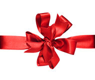 Red Bow & Ribbon. Gift red ribbon and bow isolated on white. The file includs clipping path Royalty Free Stock Image