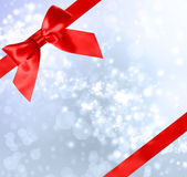 Red Bow and Ribbon with Bokeh Lights. Red Bow and Ribbon with Blue Bokeh Lights Background Royalty Free Stock Photo