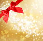 Red Bow and Ribbon with Bokeh Lights. Red Bow and Ribbon with Gold Bokeh Lights Background Stock Photography