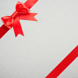 Gift with red bow. Red bow and ribbon over wrapped gift Royalty Free Stock Image